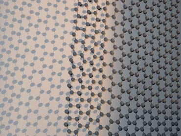 Graphene kinetic sculpture with moire pattern shadows, detail.